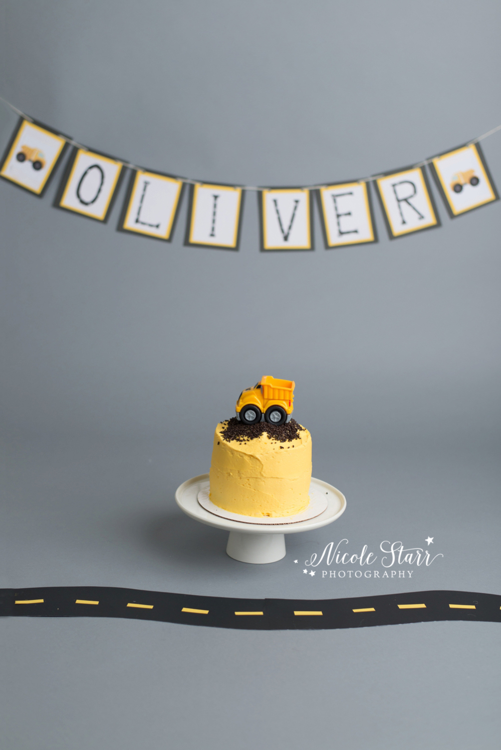 Construction truck first birthday cake smash with Saratoga Albany NY baby photographer