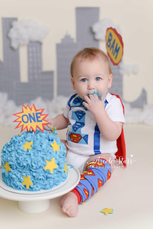 superhero baby first birthday cake smash.jpg