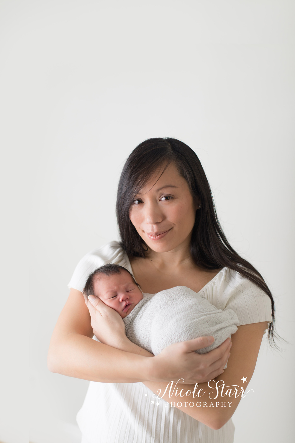 Beautiful mother and newborn baby photograph