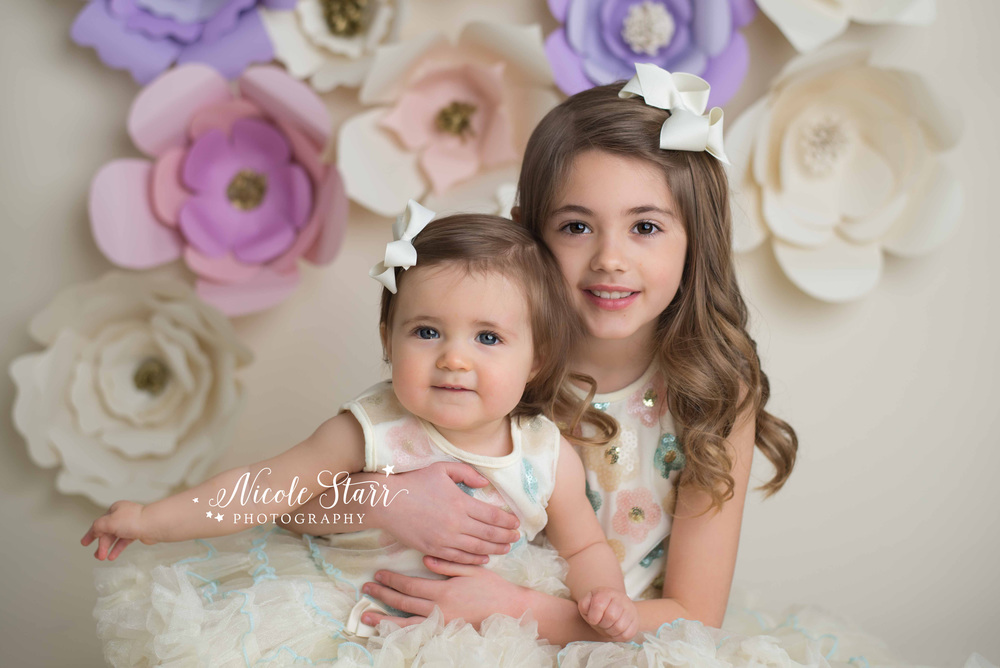 sisters with pastel colors and a floral spring studio session