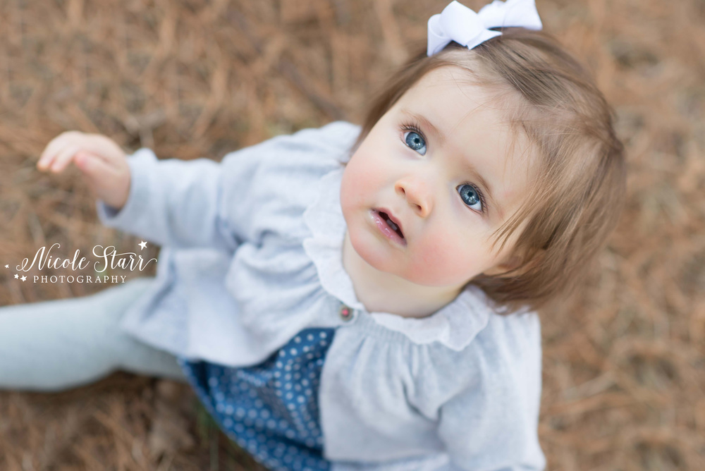 outdoor family photo session baby girl with big blue eyes.jpg
