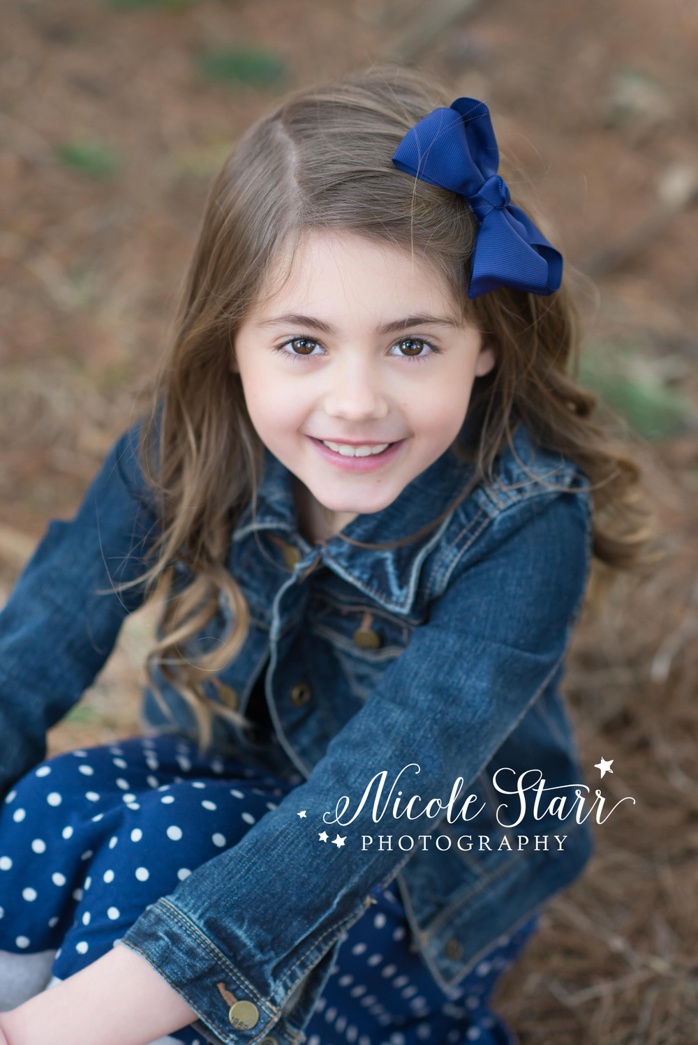 little girl with a jean jacket for a rustic photo session.jpg