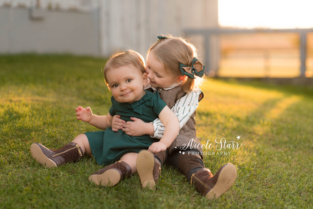 sisters at rustic family photos at pitney meadows community farm in saratoga springs