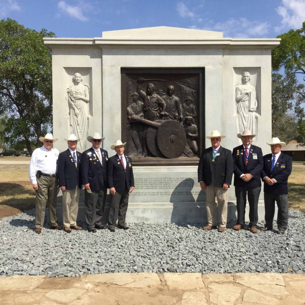 "Alamo Chapter members   Jim Massingill, Ken Pfeiffer, Jimmy Peet, Ed Heath, Dick Weitzel, Al Davis  , and Tommy Cox (not pictured) join   President-General Robert Kendall   in celebrating the 180th anniversary of the ""Come and Take It"" confrontation between the Mexican Army and citizens of Gonzales. This event is considered the first shots of the Texas Revolution. Dick Weitzel presented a $1,000 check from the Alamo Chapter to produce and install an interpretive panel (one of four) at the site near Cost, Texas."