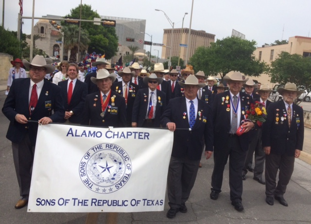 "Twenty eight members of the combined Alamo an Travis SRT Chapters participate in the April 20, 2015 DRT  ""Pilgrimage to the Alamo"".    Chris Lancaster, Ed Heath, AlDavis, Dick Weitzel   and   Joe Weathersby   in the front row and   Joey Groff, Hector Pacheco, Robert Bohmfalk, Jason Chall, Jim Massingill   and   Fred Pfeiffer   in the second row. Every year since 1925 the Alamo Mission Chapter of the Daughters for the Republic of Texas (DRT) has staged the annual Pilgrimage to the Alamo. This is a memorial tribute to the Alamo Heroes and the heritage of Texas. A solemn wreath bearing procession of historic, civic, patriotic, military and school groups depart from the Vietnam Memorial at the Tobin Center, at 3:30 p.m., and walk silently to the Alamo. Simultaneously, an authoritative voice intones the names of the Alamo defenders from inside the Alamo walls. Following the procession and placing of the wreaths on the Alamo greensward, a brief memorial service takes place . The Fiesta Military Coordinator delivers the address and the sounding of Taps ends the ceremony."