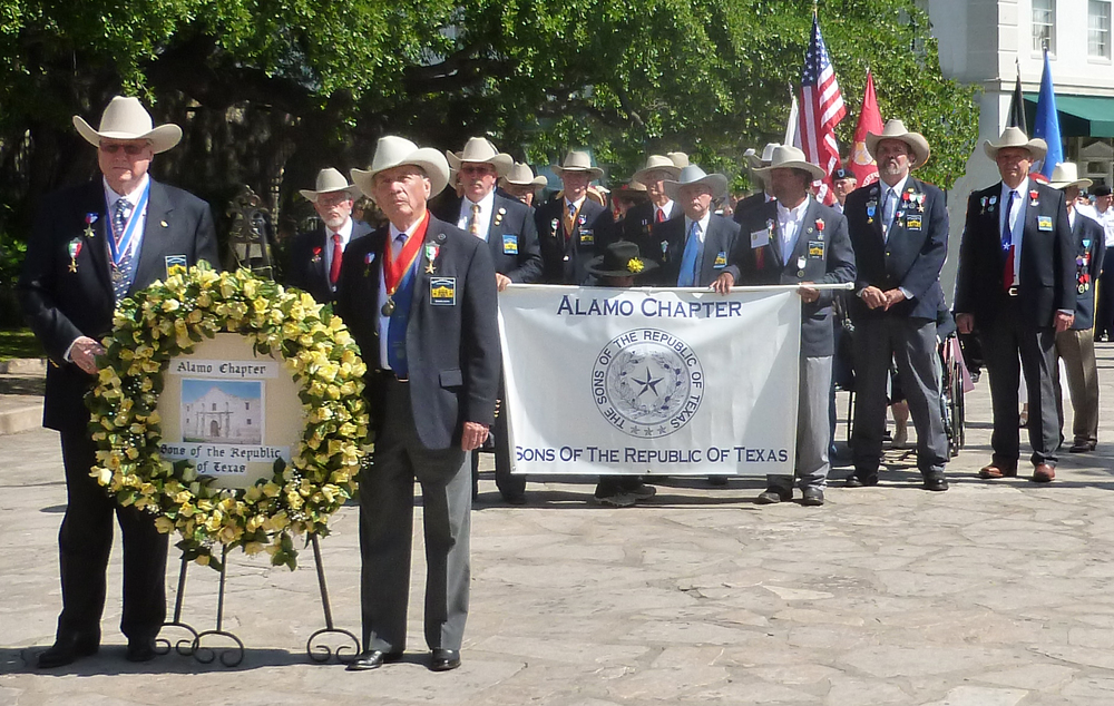 Every year since 1925 the Alamo Mission Chapter of the Daughters for the Republic of Texas (DRT) has staged the annual Pilgrimage to the Alamo. This is a memorial tribute to the Alamo Heroes and the heritage of Texas. A solemn wreath bearing procession of historic, civic, patriotic, military and school groups depart from the Vietnam Memorial at the Tobin Center, at 3:30 p.m., and walk silently to the Alamo. Simultaneously, an authoritative voice intones the names of the Alamo defenders from inside the Alamo walls. Following the procession and placing of the wreaths on the Alamo greensward, a brief memorial service takes place . The Fiesta Military Coordinator delivers the address and the sounding of Taps ends the ceremony.