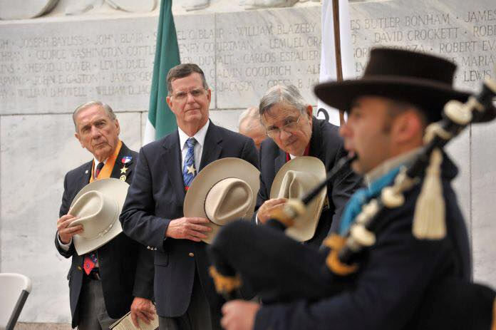 "2nd Vice-President General  Ed Heath  ,  Treasurer General  Ken Pfeiffer  , &  Admin of Education  Al McCutcheon   lower their hats in respect to the fallen, as SRT Alamo Chapter Member   Brian Shajari   plays bagpipes at the "" After The Fall of The Alamo "" ceremony in Alamo Plaza."