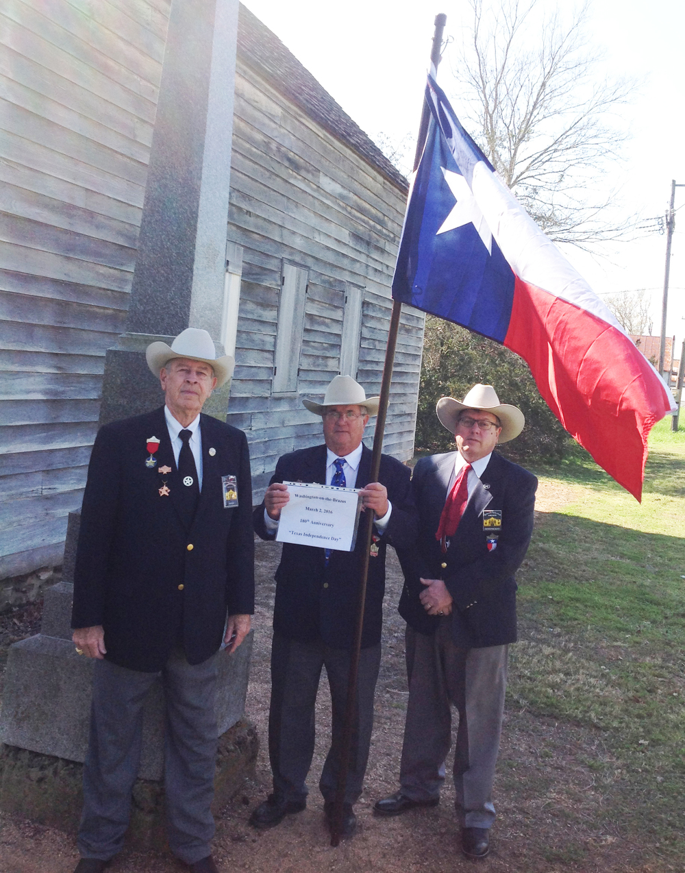Tommie Wood  , Sgt-at-Arms & 400 Flags Committee Chairman   Al Davis   &   Christopher Lancaster   pose in front of a replica of Independence Hall at Washington-on-the-Brazos.