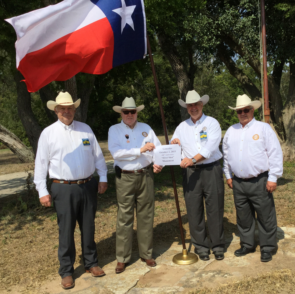 "Chapter President      Dick Weitzel  , District Rep   Jim Massingill  , 2nd VP   Jimmy Peat   & Sgt-at-Arms & Flags 400 Chairman   Al Davis   raise flags where the "" First Shot "" of the Revolution was heard, Gonzales, Texas.  After Gonzales, the Flags 400 Committee will hoist flags at The Battle of Bejar, Washington-on-the-Brazos, The Alamo, Goliad & San Jacinto."