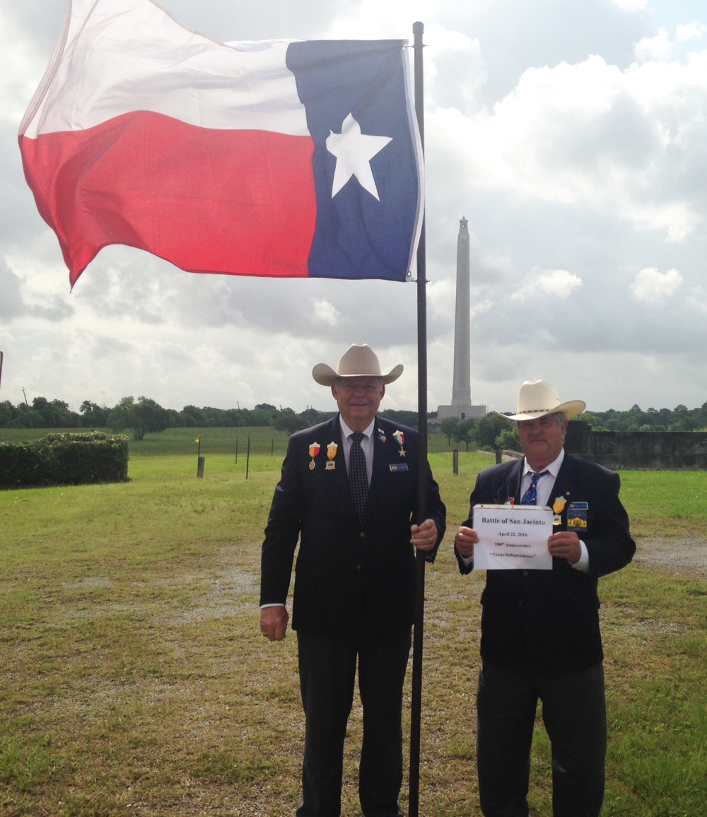 With the 570 foot San Jacinto Monument as a backdrop,  Chapter President    Dick Weitzel   & Sgt-at-Arms & Flags 400 Committee Chairman   Al Davis   hoist the last set of flags at San Jacinto, the battle that won Texas's Independence!