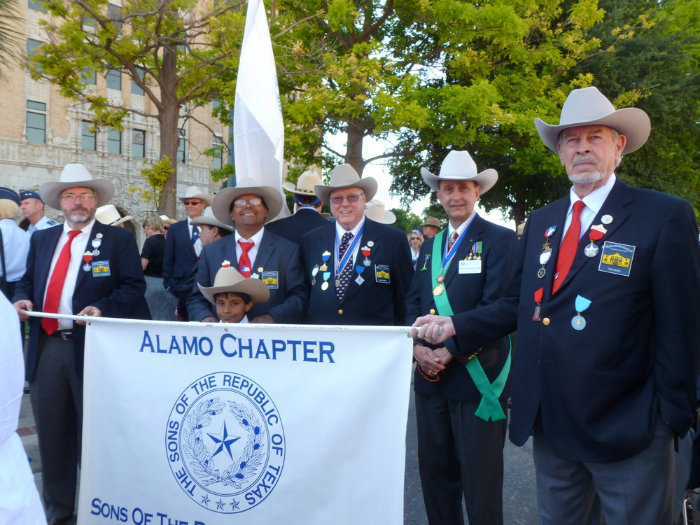 (   David Kuykendall, Joe Lopez,   President   Jim Massingill  , President-General   David Hanover   &   Tommy Wood   )Every year since 1925 the Alamo Mission Chapter of the Daughters for the Republic of Texas (DRT) has staged the annual Pilgrimage to the Alamo. This is a memorial tribute to the Alamo Heroes and the heritage of Texas. A solemn wreath bearing procession of historic, civic, patriotic, military and school groups depart from the Vietnam Memorial at the Tobin Center, at 3:30 p.m., and walk silently to the Alamo. Simultaneously, an authoritative voice intones the names of the Alamo defenders from inside the Alamo walls. Following the procession and placing of the wreaths on the Alamo greensward, a brief memorial service takes place . The Fiesta Military Coordinator delivers the address and the sounding of Taps ends the ceremony.
