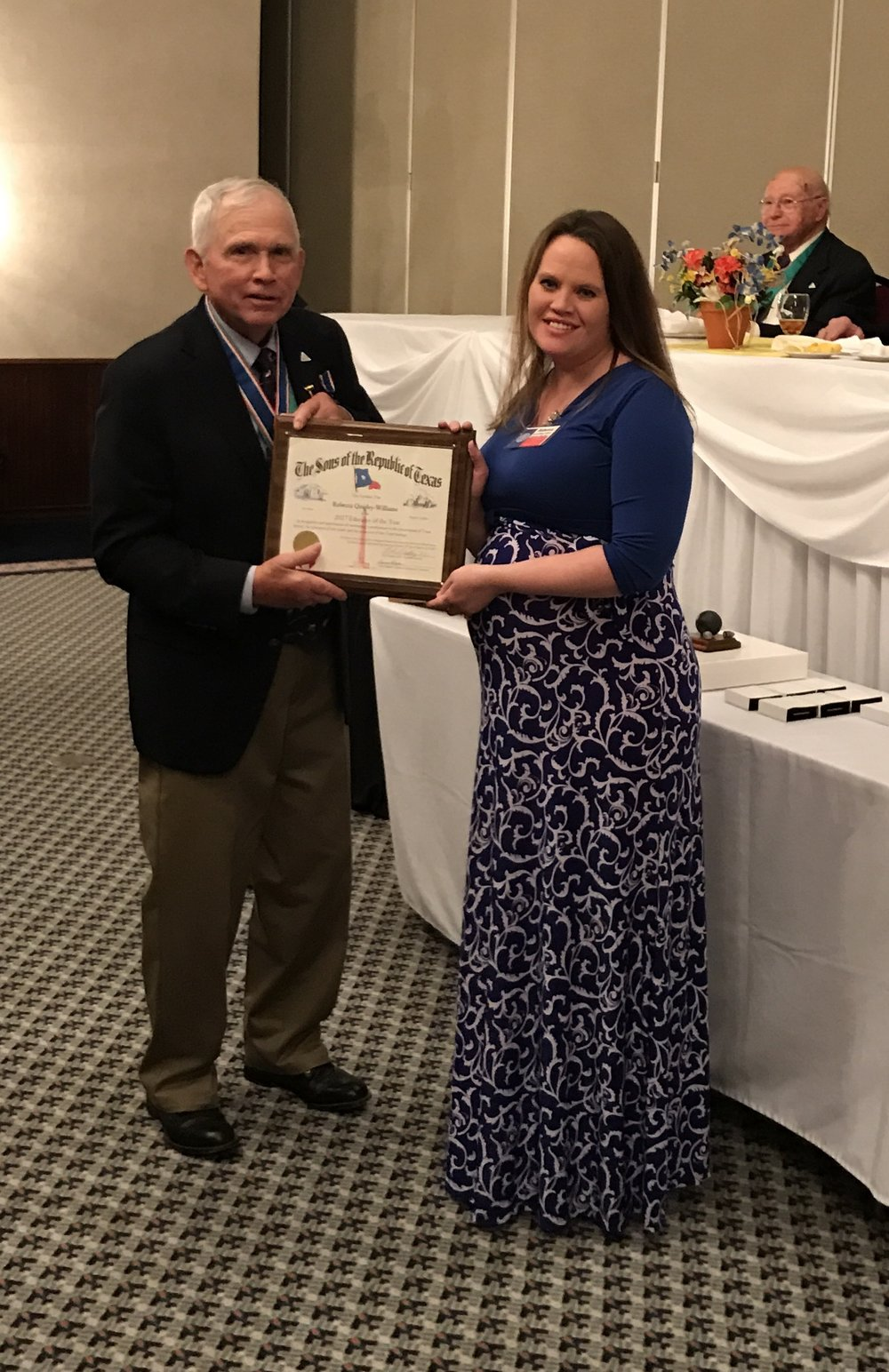 Rebecca Williams  of Schertz-Cibolo-Universal City Independent School District receives the 2016  Educator of the Year Award  from SRT  President General  Bob Steakley   at the YO Ranch Resort in Kerrville, Texas on March 18th.  Mrs. Williams  has been instrumental in the success of the Alamo Chapter's Texas Proud Essay Contest.