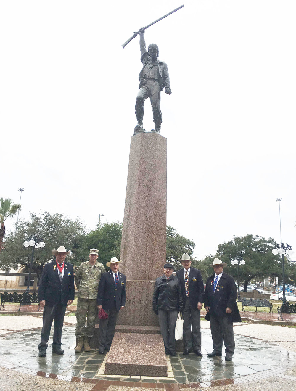 "Marketing Officer  Dick Weitzel,  2nd VP  Tom Jones,  1st VP General  Ed Heath,  Admin. of Historical Events  Bob Benavides,  1st VP  John Meehan   &  Sgt-at-Arms    Al Davis   representing the Alamo Chapter pay tribute on a rainy Dec 7, 2017 to the life and passing of Ben Milam, hero of the Texas Revolution. Without Ben and his famous December 1835 "" Who will go with Old Ben Milam into San Antonio "", there might not have been a Texas Republic. His leadership led to the tough fight and ultimate surrender of the Mexican garrison under General Cos at the cost of Ben's life. This was the Chapter's 9th Memorial to this hero of the Texas Revolution."