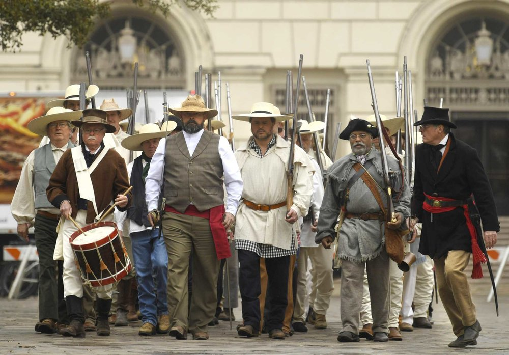 Alamo Chapter  Past President    Jason Chall   ( 3rd from right ) marches with 31 other men representing the Immortal 32 from Gonzales, on March 1st at the Alamo. Many of the volunteers were descendants of the famed 32, Jason's ancestor was  Jesse McCoy .