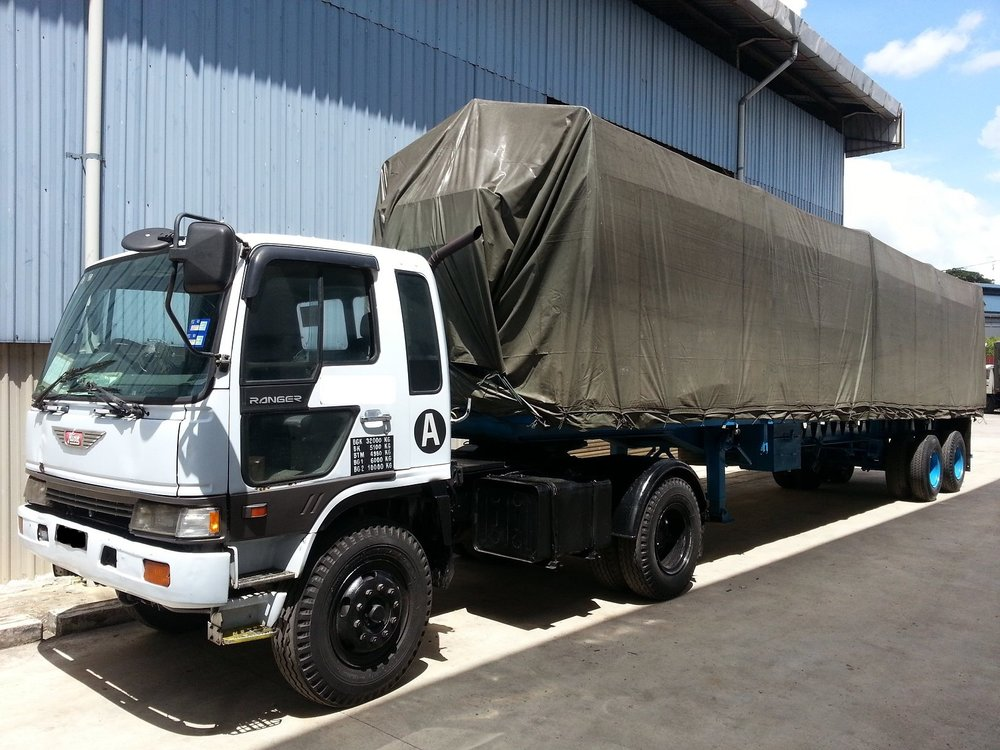 Truck Tarpaulin / Truck Covers - Protect your cargo with our UV and tear resistant heavy duty truck tarpaulin covers.