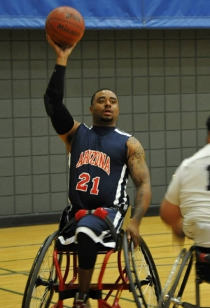 Pictured: Chris playing wheelchair basketball for the University of Arizona