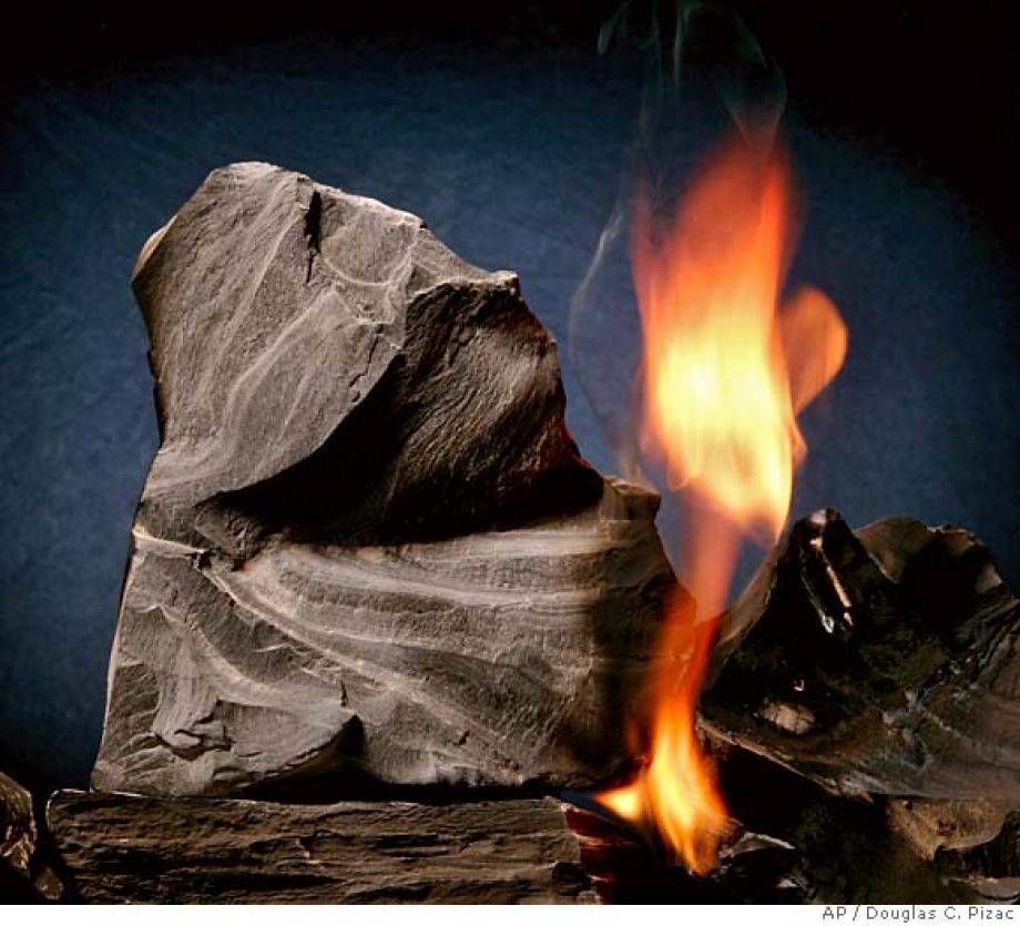 Oil shale rock burns on its own once lit with a blowtorch (Credit: Douglas C. Pizac)