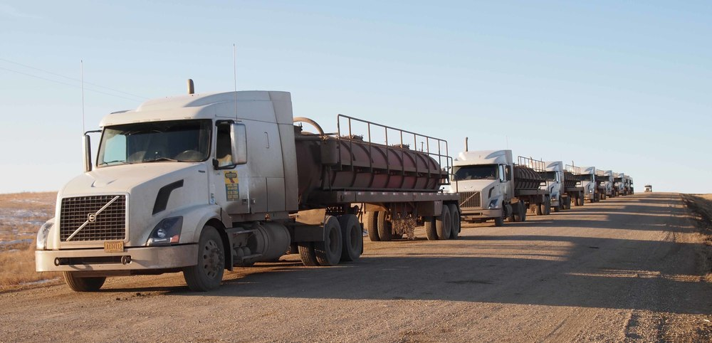 A fleet of trucks delivering water to North Dakota for hydraulic fracking (Credit: A. Dalrymple/Forum News)