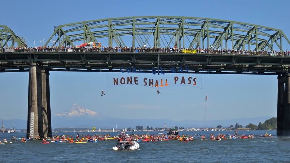 """Coal, Oil, Gas: None Shall Pass"" Hundreds of activists blockade Columbia River in protest against fossil fuel shipments (Credit: Portland Rising Tide)"
