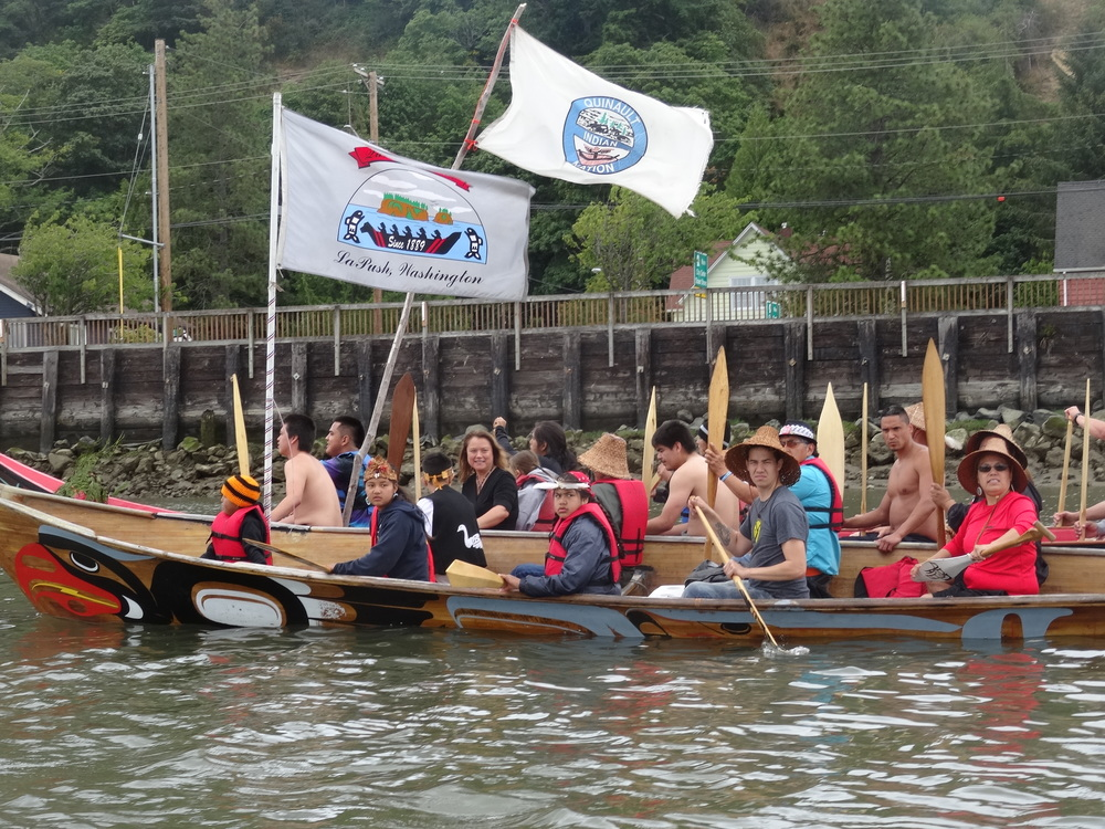 "Quinault and Quileute canoes join in preparation for landing in Hoquiam for the ""Shared Waters, Shared Values"" rally on July 8, 2016 (Credit: Zoltan Grossman)."