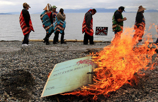 Lummi Nation Council symbolically burns a $1 million check from the terminal company (Credit: Blades).