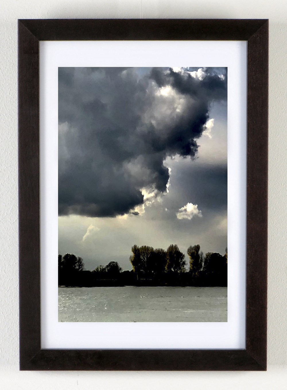 Storm  Year: 2017  Photoprint under glass  Size: 30x45 cm  Outside measurement: 34x49 cm  Frame: Alderwood Brown  Paper: Fuji Crystal Archive Glossy  Acrylic Glass 2 mm Glossy  Price per framed image: € 379  Please contact us for frame variety.
