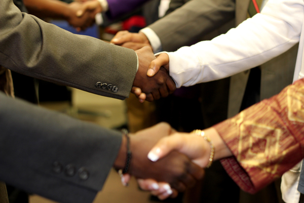 Deals getting done. Image: Spot Us/Flickr. License:CC BY-SA 2.0