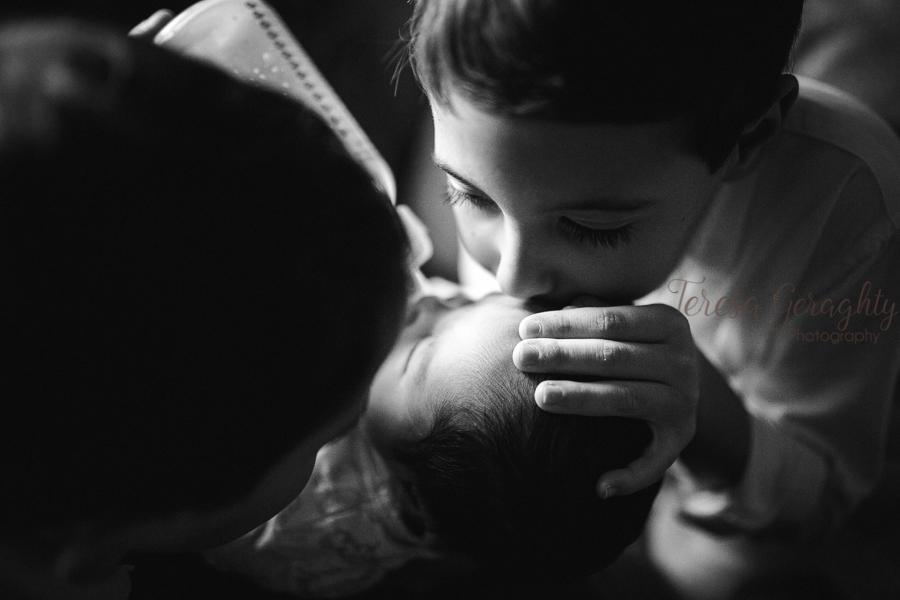 boys kissing baby