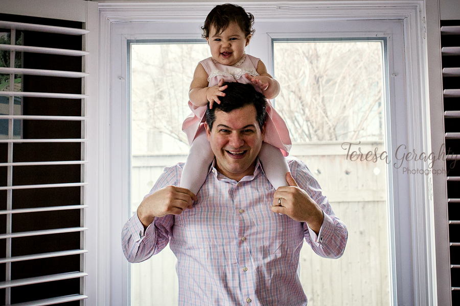 dad with baby on shoulders