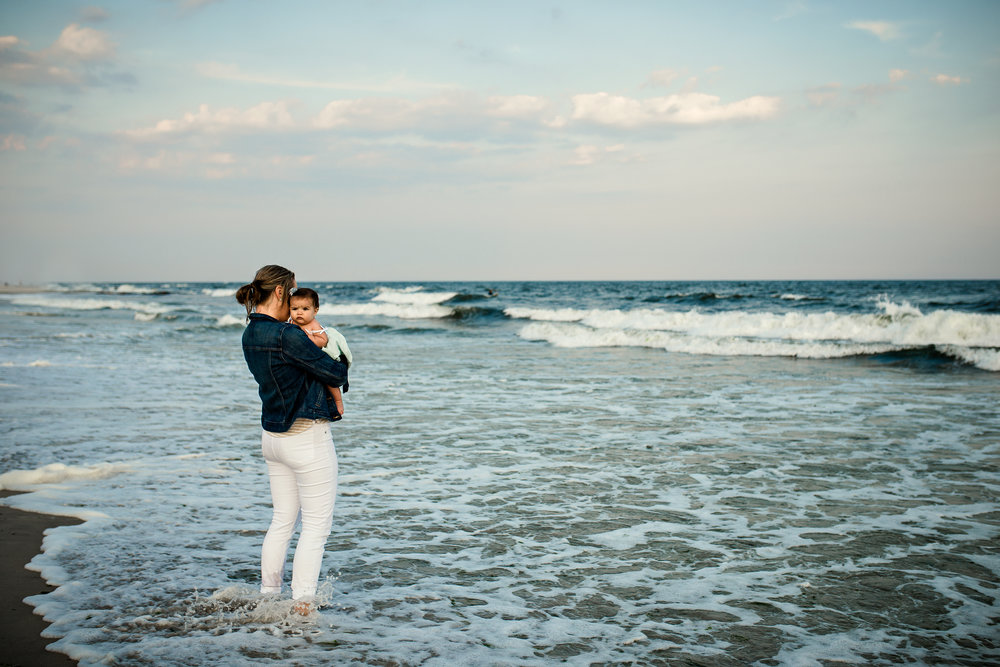 Mom and baby by the ocean