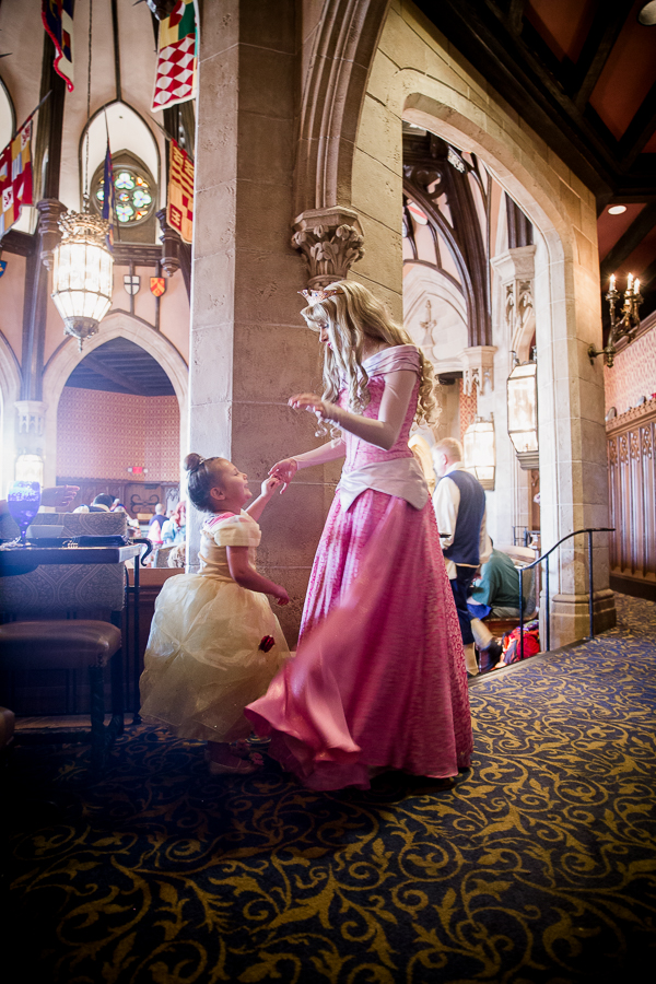 girl and aurora at cinderella's royal table