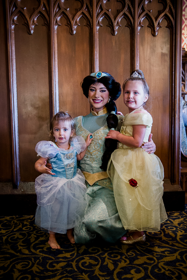 girls with Jasmine at cinderella's table