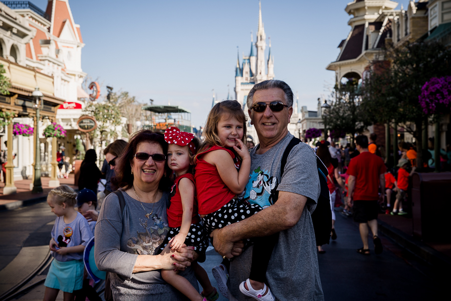 grandparents with toddlers at magic kingdom with castle