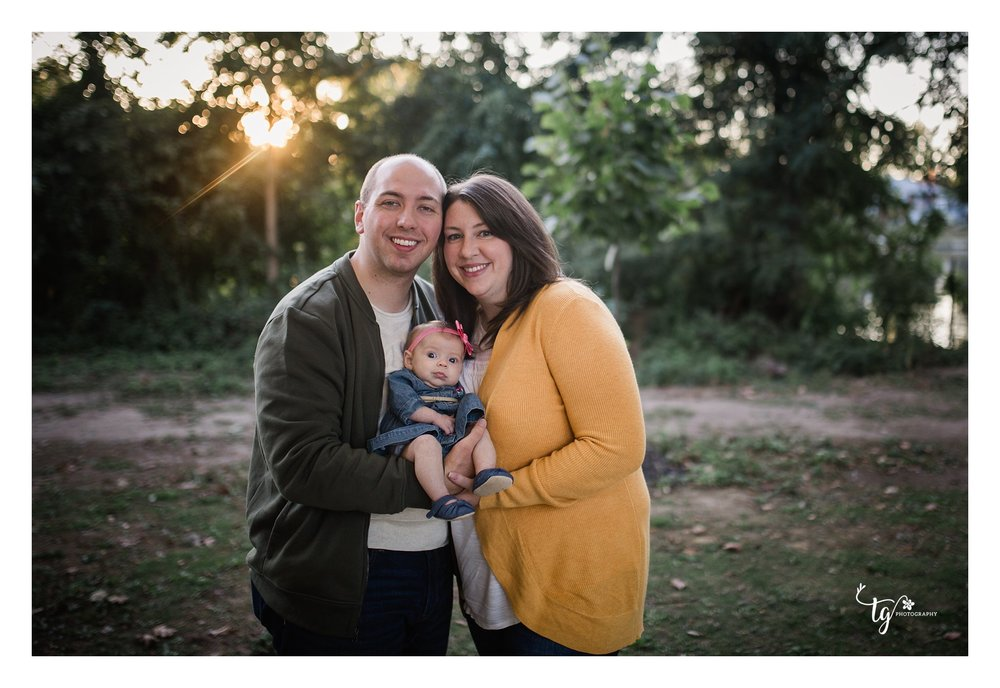 fall family portrait with newborn baby and sunset