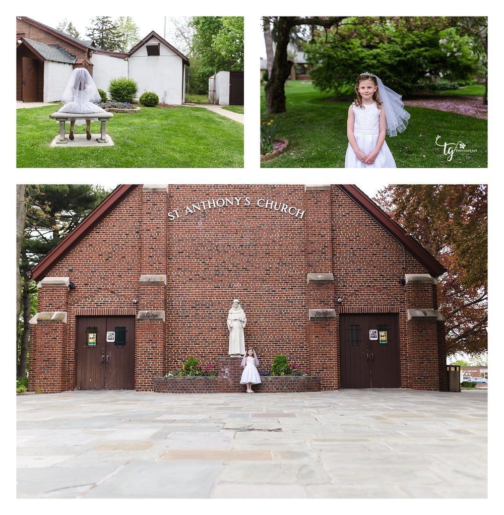 girl in communion dress outside of church with brick wall and in the garden of the church