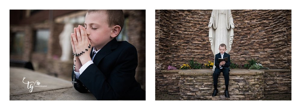 boy in communion suit praying against a rock wall
