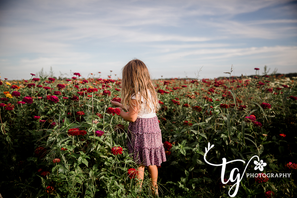 toddler girl with wlldflowers