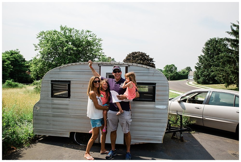 family in front of newly purchased 1969 playmor camper