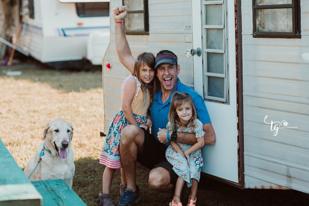 family in front of RENOVATED 1969 playmor camper