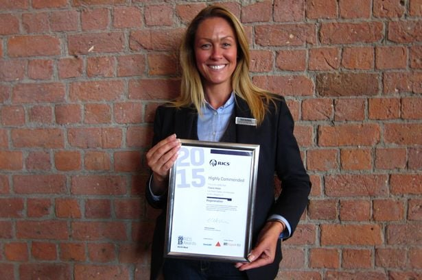 Vicki Walberg, assistant to the executive office at Titanic Hotel Liverpool with just one of several awards won by the hotel in 2015