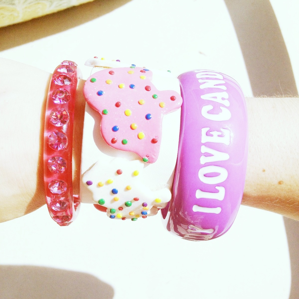 "animal cookie bracelet from katy perry's website.  ""i love candy"" by dylans candy bar."