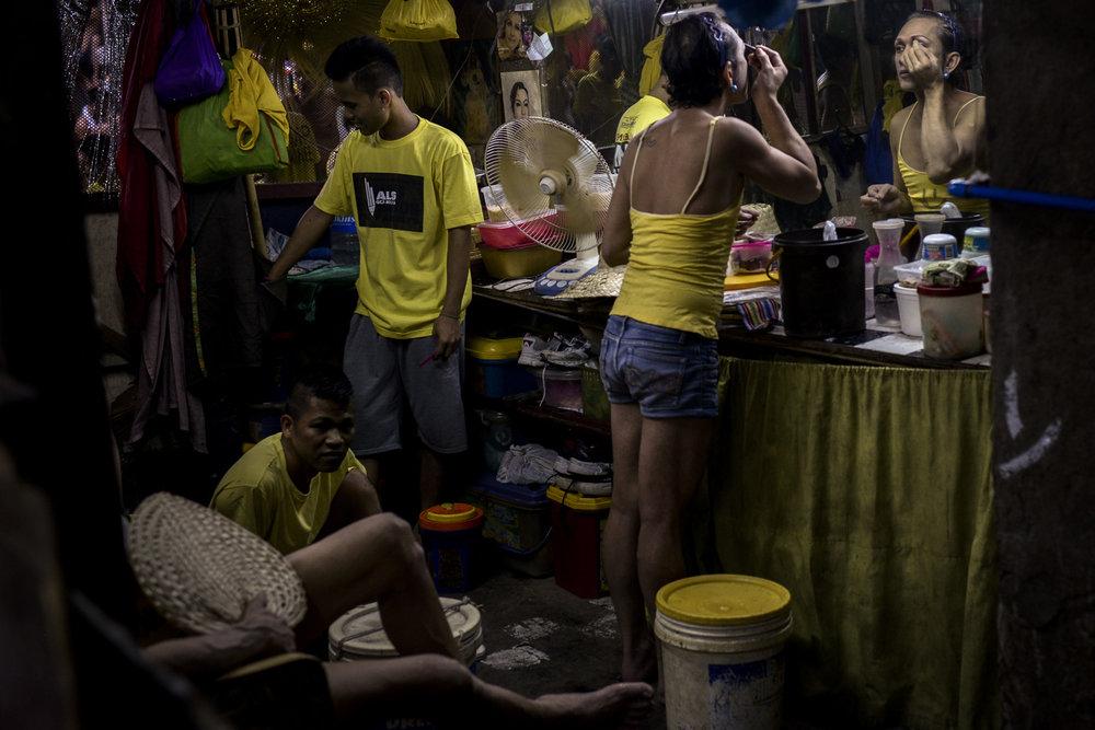 A transgender woman puts on makeup inside the Quezon City Jail.