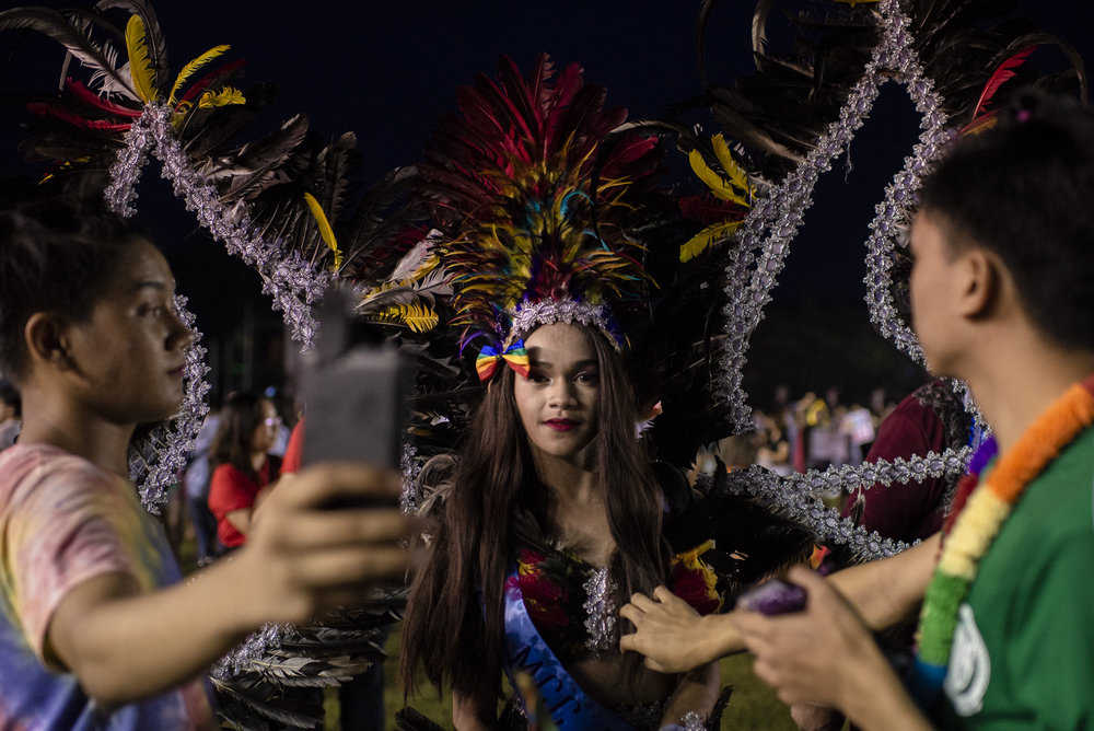 A transgender woman prepares for a Pride March, annual gathering of members of the LGBTQIA+ community, in Marikina, Philippines.