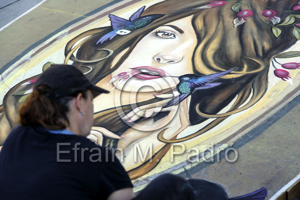 Artist working on chalk art piece, Chalk Art Festival, Larimer Square, Denver, Colorado