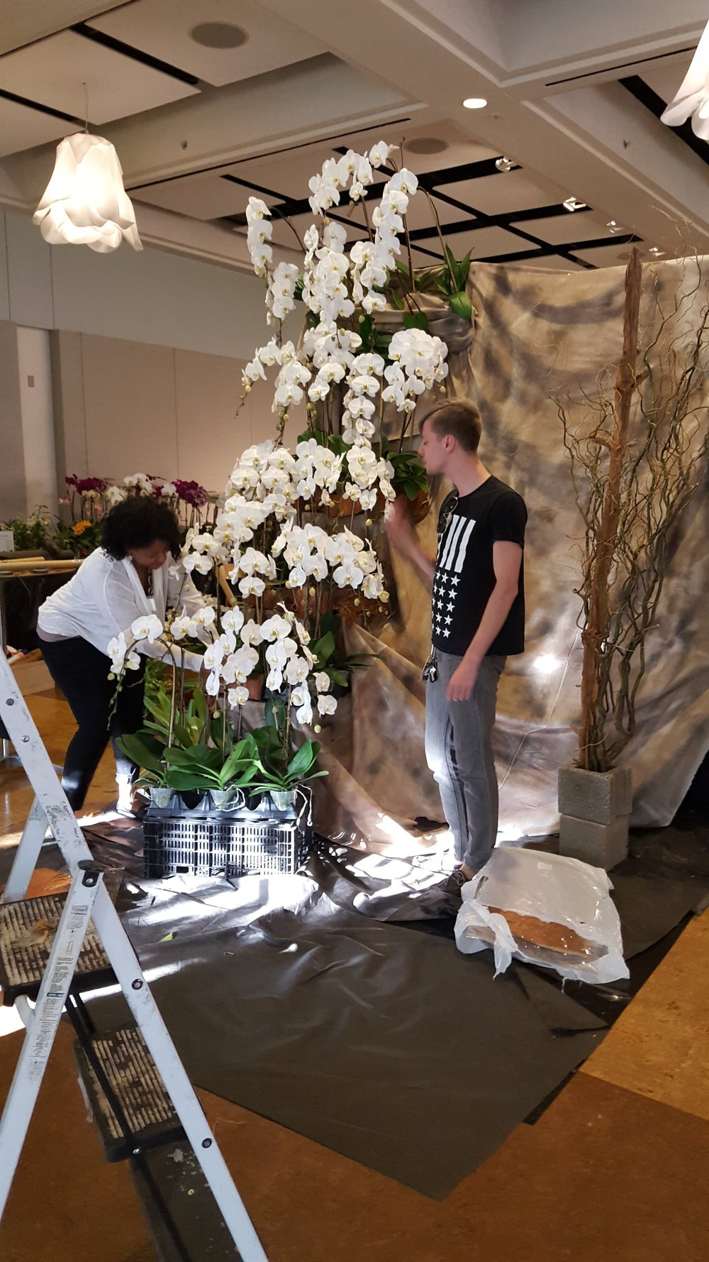 Saundra Nixon and Kyle Broflovski help assemble the exhibit.