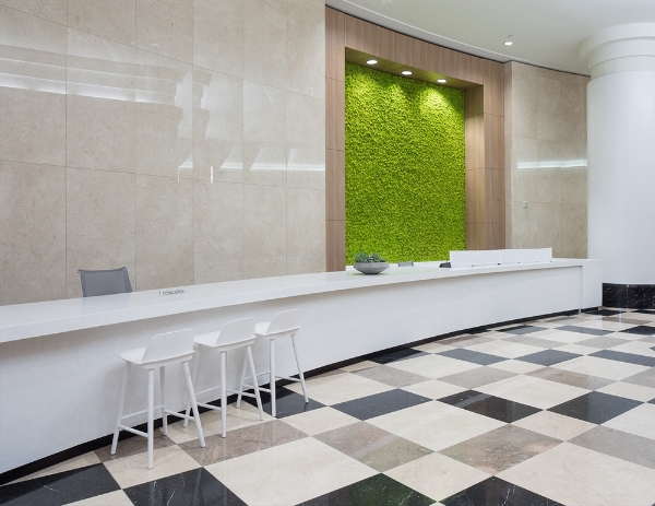 This moss wall panel at Regions Plaza brings life to the elevator lobby, with a dramatic color pop and texture pop that draw it into the spotlight while flattering the smooth, whiteness of the white stone and tile.