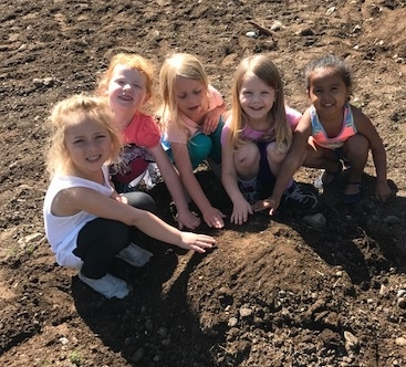 Preschool farmers plant giant pumpkins!