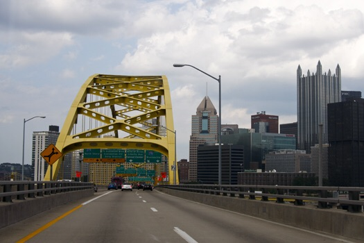 Pittsburgh and Cincinnati have rival sport teams and rival yellow bridges.