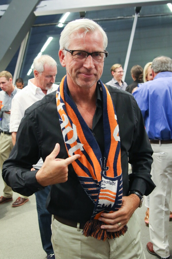 Crystal Palace FC Head Coach Alan Pardew donning a DI scarf.
