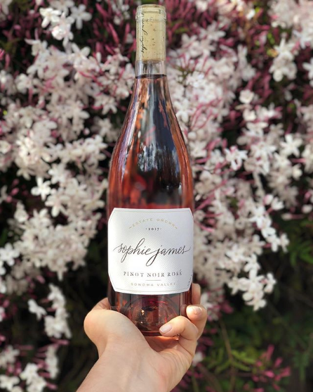 "A   bottle of her favorite Rosé, or even better, a membership to an ultra-fun wine ""tribe"" like Sophie James in Sonoma"